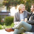 Couple Relaxing On Park Bench — Stock Photo #50697885