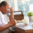 Senior Man Writing Memoirs In Book — Stock Photo #50698199