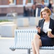 Businesswoman  Using Mobile Phone — Stock Photo #50698227