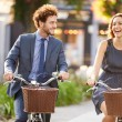 Couple Riding Bike in City Park — Stock Photo #50698249