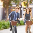 Couple Riding Bike in City Park — Stock Photo #50698301