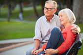 Mature Couple Sitting On Bench — Stock Photo