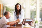 Senior Father Discussing Document With Daughter — Stock Photo