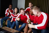 Sports Fans Watching Game On TV — Stock Photo