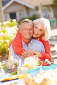 Mature Couple Eating Meal In Garden — Stock Photo