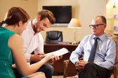 Couple Talking To Financial Advisor — Stock Photo