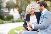 Business Couple Using Digital Tablet — Stock Photo