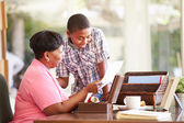 Grandmother Showing Document To Grandson — Stock Photo