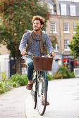Man Cycling Through Park — Stock Photo