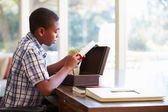 Boy Looking At Document — Stock Photo