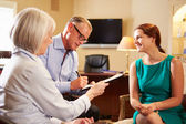 Older Couple Talking To Financial Advisor — Stock Photo