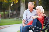 Mature Couple Sitting On Park Bench — Stock Photo