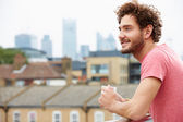 Man Relaxing On Roof Terrace — Stock Photo