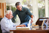 Adult Son Helping Father With Laptop — Stock Photo