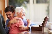 Grandson Hugging Grandmother — Stock Photo