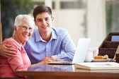 Grandson Helping Grandmother With Laptop — Stock Photo