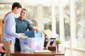 Father Helping Teenage Son Pack — Stock Photo