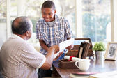 Grandfather Showing Document To Grandson — Foto de Stock