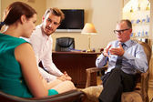 Couple Talking To Male Counsellor — Stock Photo