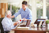 Grandfather Showing Document To  Grandson — Stock Photo