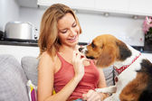 Woman Playing With Pet Dog — Stock Photo