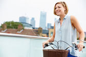 Woman Pushing Bike — Stockfoto