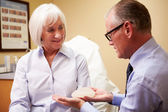 Woman Discussing Breast Augmentation — Stockfoto