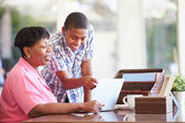 Boy Helping Grandmother With Laptop — Stock Photo