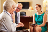 Older Couple Talking To Counsellor — Stock Photo