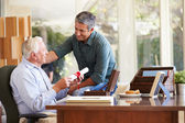 Father Discussing Document With Son — Stock Photo