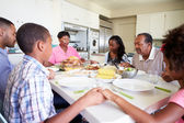 Multi-Generation Family Eating Meal — Stock Photo