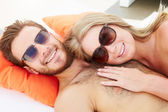 Couple  Relaxing By Swimming Pool — Stock Photo