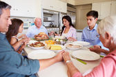 Family Saying Prayer Before Eating Meal — Stock Photo