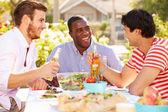 Three Male Friends Enjoying Meal — Stock Photo