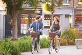 Couple Riding Bike in City Park — Stock Photo