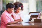 Girl Helping Grandmother With Laptop — Stock Photo
