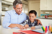 Hispanic Father Helping Son With Homework — Stock Photo
