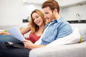 Couple Looking Through Personal Finances — 图库照片