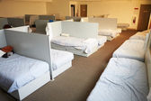 Empty Beds In Homeless Shelter — Stock Photo