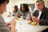 People  Eating In Homeless Shelter — Stock Photo