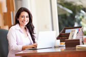 Hispanic Woman Using Laptop — Stock Photo