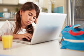 Unhappy Hispanic Girl Using Laptop — Stock Photo
