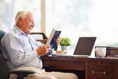 Senior Man  Looking At Photo Frame — Stock Photo
