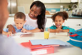 Mother Helping Children With Homework — Stock Photo