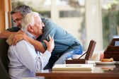 Senior Father Being Comforted By Son — Stock Photo