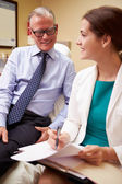 Doctor In Consultation With  Patient — Stockfoto