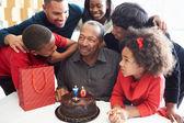 Family Celebrating 70th Birthday — Stock Photo
