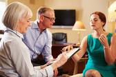 Couple Talking To Financial Advisor — Stock Photo