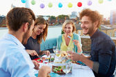 Group Of Friends Eating Meal — Stockfoto