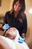 Man Having Dermabrasion Cosmetic Treatment — Stock Photo